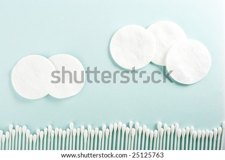 cotton discs and sticks landscape, blue background