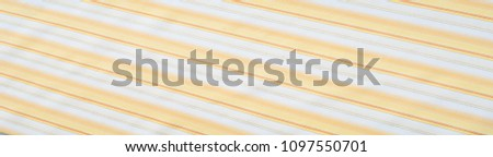 Cotton fabric texture, background, striped, with yellow stripes #1097550701