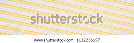 Cotton fabric texture, background, striped, with yellow stripes #1132236197