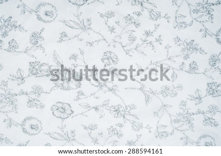 Cotton fabric texture, background, white, with painted flowers. a soft white fibrous substance that surrounds the seeds of a tropical and subtropical plant