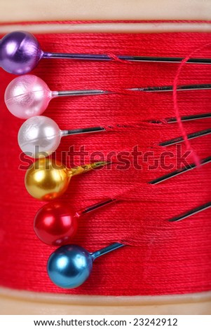 cotton reel with coloured pins