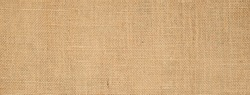 Cotton woven fabric background with flecks of varying colors of beige and brown. with copy space. office desk concept / Hessian sackcloth burlap woven texture background