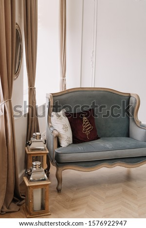 Couch Old Style with Pillows near Street Lamps Standing on Wooden Floor Copyspace. Elegant Sofa, Elegant Curtains and Mirror, White Wall on Background. Cozy Room Interior Photography