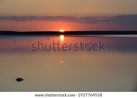 coucher de soleil lagune l'Afrique africa sunset pink Foto stock ©