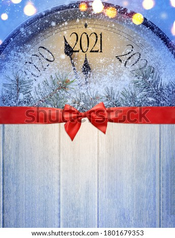 Countdown to midnight. Retro style clock on wooden table is counting last moments before Christmas or New Year 2021. View from above.