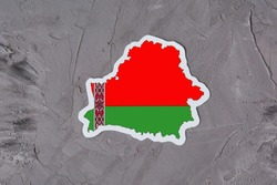 Country border outline map of Belarus. Shape and national flag of the Republic of Belarus on grey concrete background. Election concept.