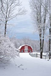 Country Christmas, a rural red barn contrasting white snowy winter weather and overcast sky