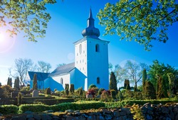 Country church at Bredsten, Jutland, Denmark. The onion shapes tower top it not typical for Danish churches.