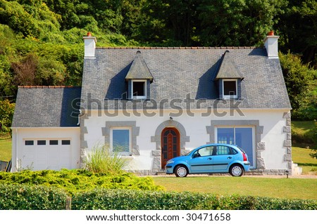 Country cottage house and car, Bretagne Brittany, France.