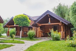 Country cottages with log and timber in the green area. cozy eco-friendly houses made of natural wood, bungalows for families
