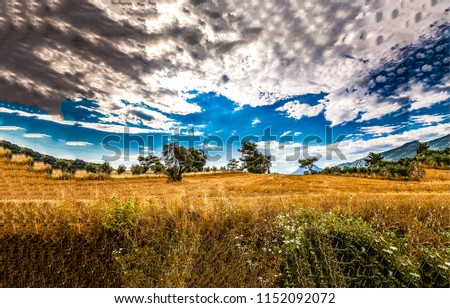 Country farm field cloudy sky landscape. Cloudy sky field panorama. Rural field cloudy sky scene
