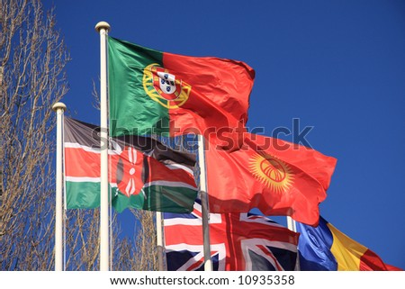 Country flags - Portugal, kenya, and Great-Britain- isolated on a blue sky