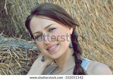Country girl on haystack background