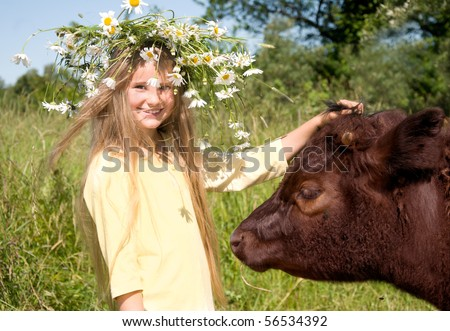Country girl with a cow