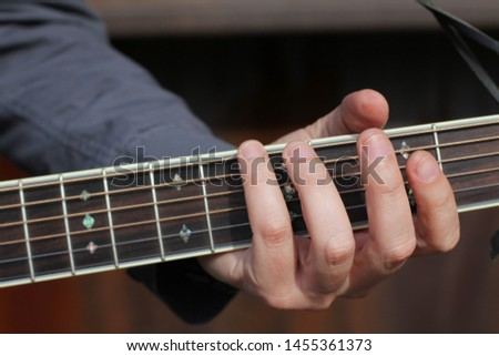 Country guitarist playing in the street