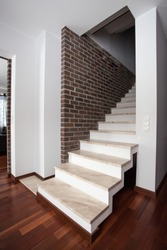 Country home - elegant stairway with brick wall