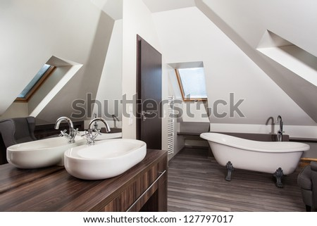 Country home - interior of a vintage attic bathroom