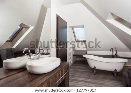Country home - interior of a vintage attic bathroom #127797017