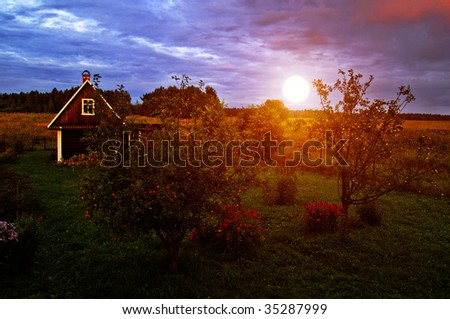 Country Hous with Apple Trees at Vivid Sunset