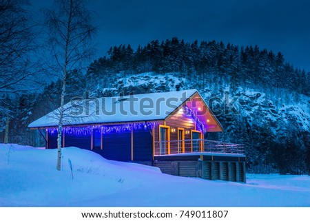Country house in the winter. The house is against the rocks. Cottage in winter. #749011807