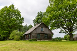 country house with oak trees in green summertime