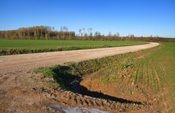 Country landscape with gravel road.