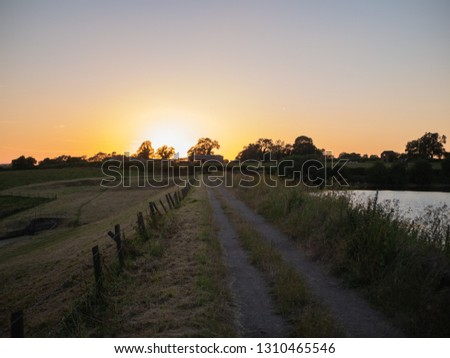 Country lane Sunset by the resevoir