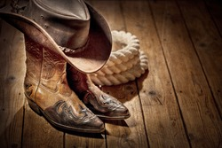 Country music festival live concert or rodeo with cowboy hat and boots background