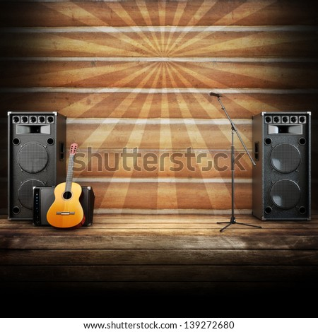 Country music stage or singing background, microphone, guitar and speakers with wood flooring and sunburst background. Advertising concept with room for text or copy space