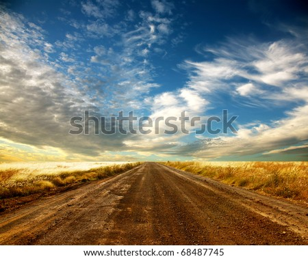 Country road and beautiful cloudscape