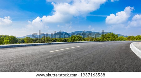 country road and green mountains in summer.