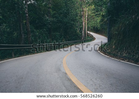 country road and journey way of traveler to the nature in the mountain and the forest.