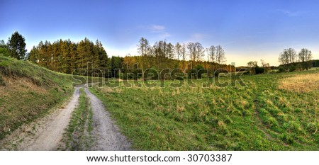 Country road and landscape panorama