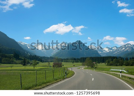 country road from rubi village to oberstdorf tourist spa town in spring. beautiful allgau landscape germany