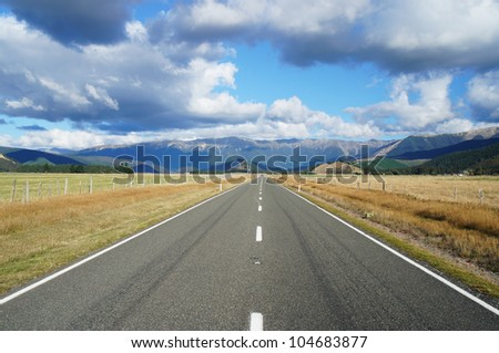 Country Road Going To Mountains on Sunny Day - New Zealand