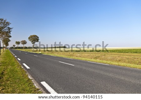 Country road in a beautiful agricultural area in northern France
