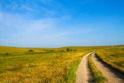 Country Road leading through the Flint Hills of Kansas