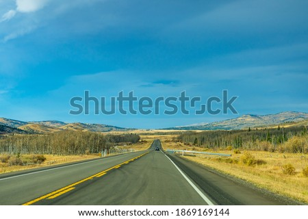 Photo of  Country road, rural landscape in autumn season. Alberta Provincial Highway No. 22, also known as the Cowboy Trail. Alberta, Canada.