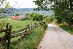 Country road through village in Serbia old traditional village in Serbia country road through village on hills