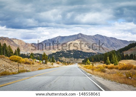 Country Road With Stormy Sky in Colorado - Shutterstock ID 148558061