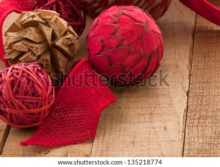 Country Style, Folk Art Christmas Ornaments on Rustic Wood with Copyspace - stock photo