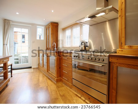 Country-style kitchen with oak floor