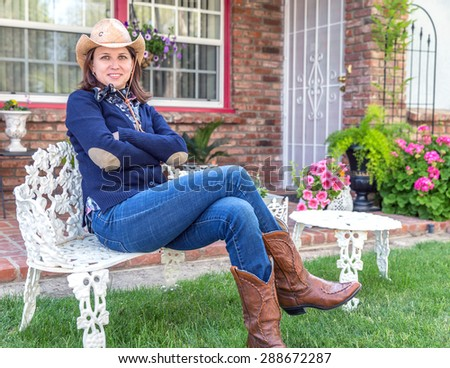 cd174b8ed49 Country style portrait of a beautiful brunette young woman wearing a cowboy  hat  288672287