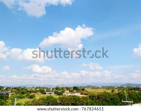 country view with clouds and blue sky background #767824651