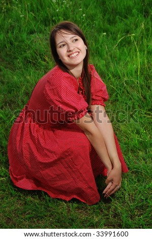 Country woman in red dress thinking about something nice