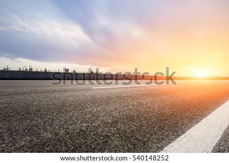 countryside asphalt road at sunset #540148252