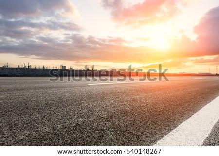 countryside asphalt road at sunset #540148267