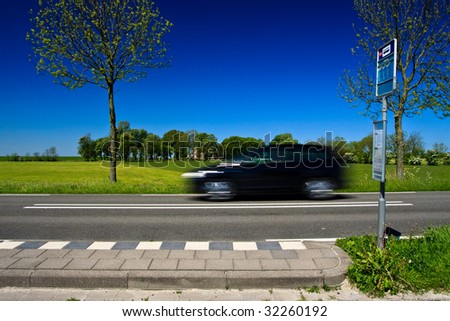 Countryside bus station with farmer, cows and car - stock photo