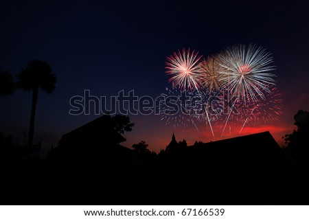 countryside home with fire works