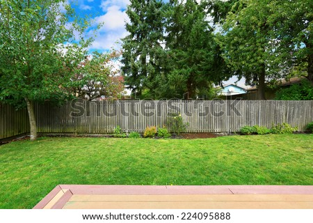 Countryside house backyard with old wooden fence. #224095888